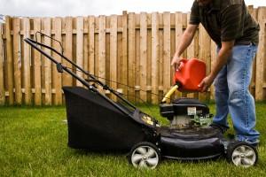 Man filling gas tank of lawn mower