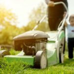 Dad and Son mowing their lawn